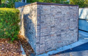 ledge stone dumpster enclosure with man door