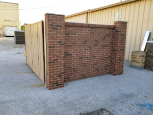 Brick Enclosure with Metal Gates and Brick Columns