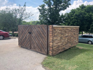 Stone Dumpster with Wood Gates Side View