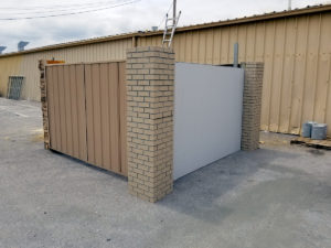 Metal Enclosure with Metal Gates and Brick Columns